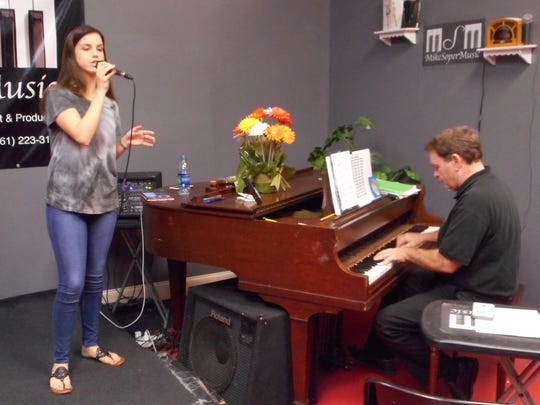 Mike Soper (right), a Hobe Sound resident with a music studio is in Welington, will accompany Martin County High School student Laura Granello (left) during her  solo vocal Saturday at the Weill Recital Hall at Carnegie Hall.