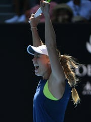 Denmark's Caroline Wozniacki reacts after beating Belgium's Elise Mertens in their women's singles semifinals match on Day 11of the Australian Open Thursday in Melbourne.