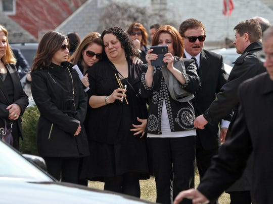 Family and friends watch as pallbearers carry the casket of Joseph Rodriguez, 28, on Wednesday at St. Elizabeth R.C. Church in Linden.