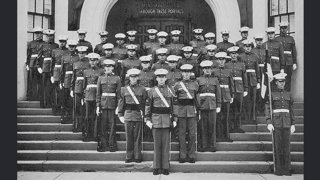 The class of 1964 at the New York Military Academy. Donald Trump stands at attention, front and center.