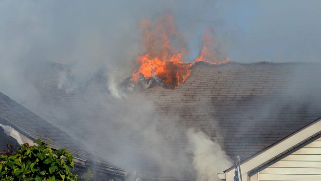 Crews respond to a fire in the 5000 block of Saddle Drive on Wednesday, Sept. 17, 2014.