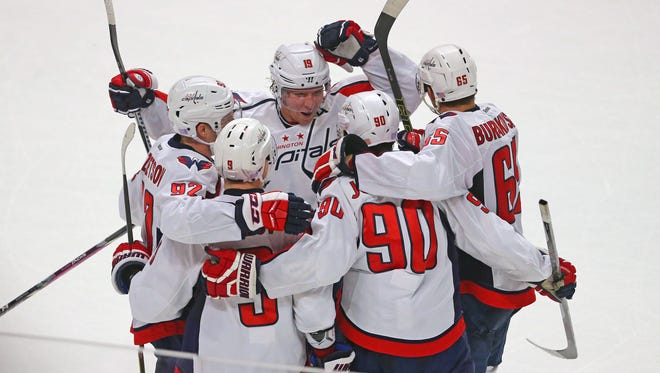 Marcus Johansson is congratulated for scoring the game-winning goal in overtime.