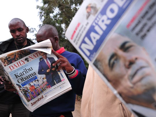 People read local newspapers with pictures of President