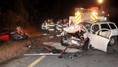 Emergency personnel work the scene after a fatal two-car