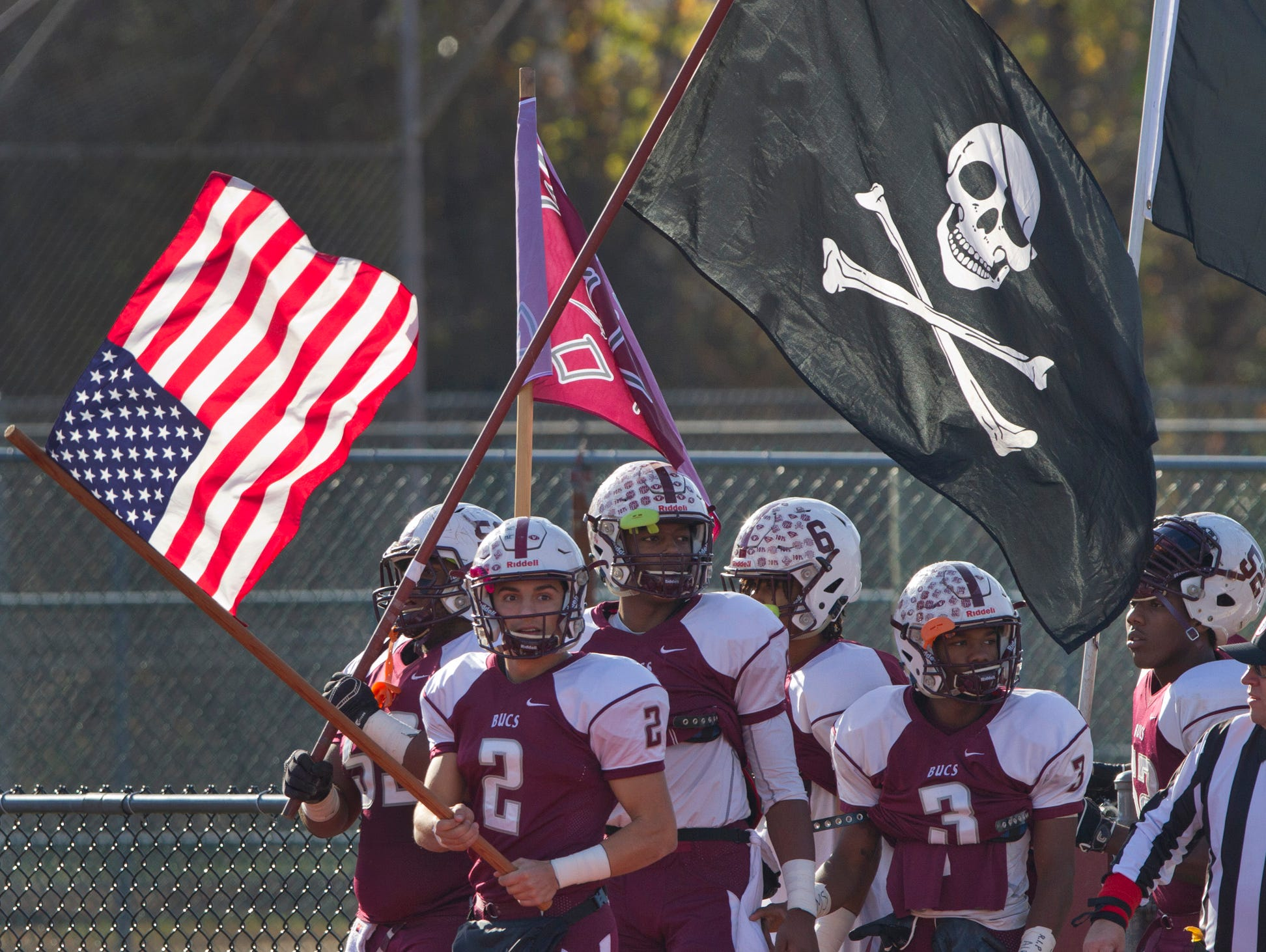 Red Bank RegionalJack Navitsky leads his team onto the field for the Long Branch vs Red Bank Regional Thanksgiving Day Football game in Red Bank NJ on November 26, 2015.