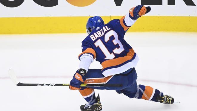 New York Islanders center Mathew Barzal (13) reacts after scoring the winning goal against the Washington Capitals during overtime NHL Eastern Conference Stanley Cup playoff hockey action on Sunday.