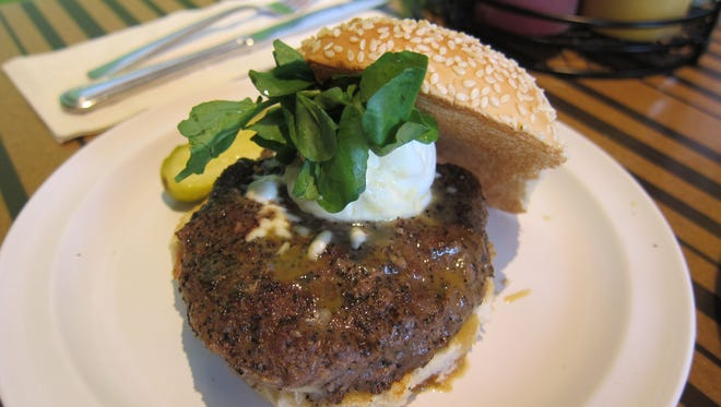 The Napa Valley burger with fresh goat cheese, watercress and Meyer lemon honey mustard.