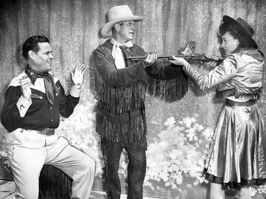 """Frank Butler, Charles Dosch and Doris Patston stage a photo from the Starlight Musicals production of """"Annie Get Your Gun"""" at the Indiana State Fairgrounds in 1951."""