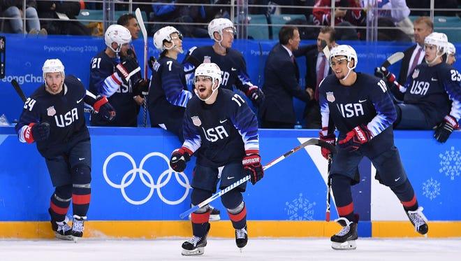 Team USA celebrates a victory over Slovakia.