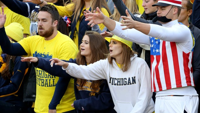 Michigan fans make noise in the student section at Michigan Stadium in Ann Arbor on Sept. 13, 2014.
