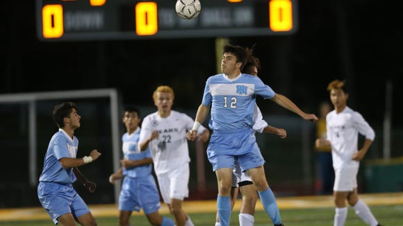 Rye Neck's Jack Sheldon (12) connects with a header during their 1-0 OT win over Briarcliff in the boys Class B soccer finals at Lakeland High School in Shrub Oak on Saturday, October 28, 2017.
