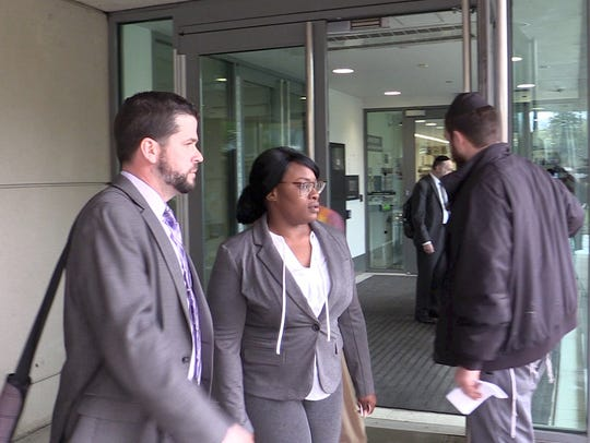 Spring Valley resident Jermika Depas, center with attorney