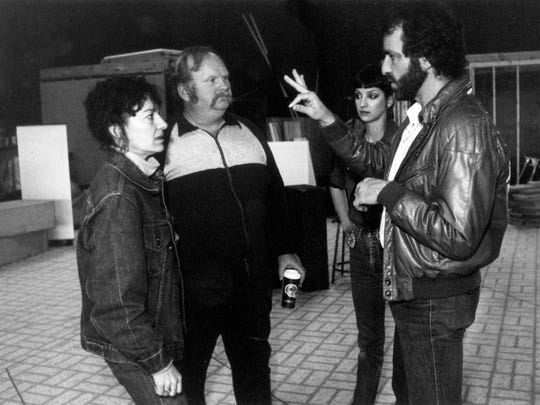 "Mark Medoff works with deaf actress Phyllis Frelich, left, and two other members of the cast for the premier of ""The Hands of Its Enemy"" in 1984 at NMSU. The production of a play about a deaf playwright followed Medoff's 1980 Tony award winning ""Children of a Lesser God,"" which also starred Frelich."