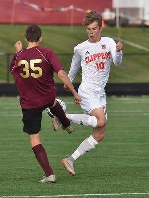 Sturgeon Bay's Jaden Stevenson, right, challenges Barron's Skyler Dwyer for the ball during the first half of a WIAA Division 4 state semifinal boys soccer game Thursday in Milwaukee.