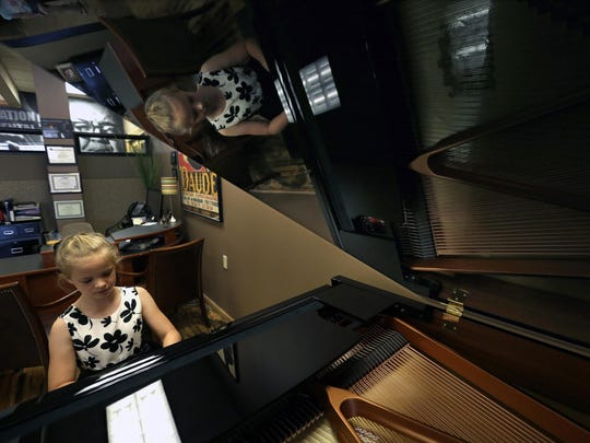 Zoe Kraus, 10, of Appleton performs her original composition
