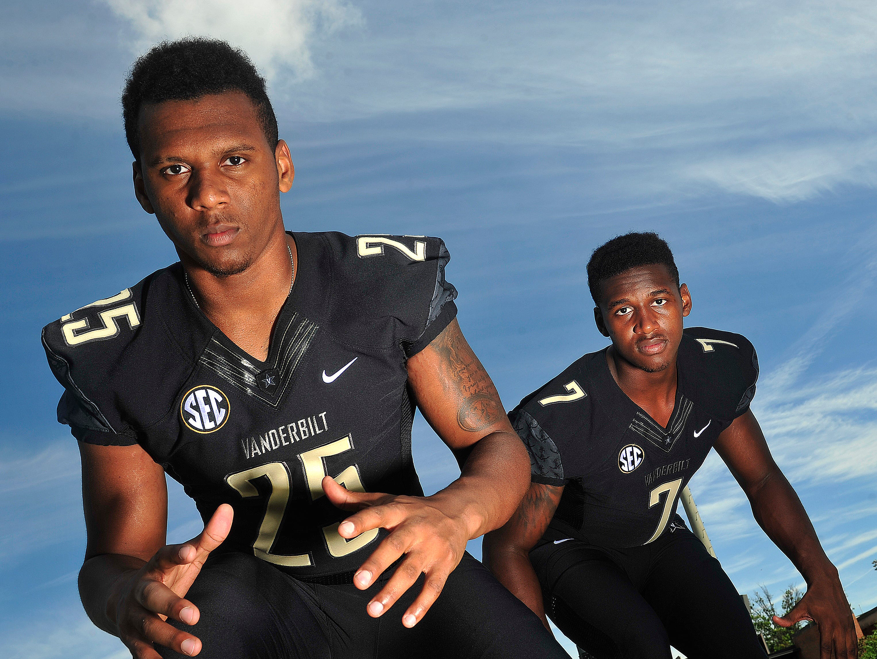Brothers Josh Smith, left, and Emmanuel Smith pose for camera at the Vanderbilt University practice field and McGugin Center on campus Nashville, Tenn. August 21, 2015.