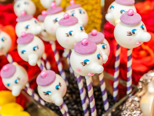 Tea pot cake pops resembling Mrs. Potts were created by Jennie Weller Catering for the Beauty and the Beast pre-party at the Alabama Shakespeare Festival.