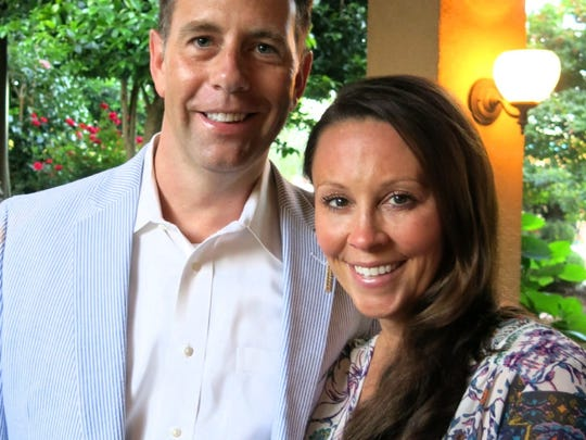 Chris and Candace Anderson at spring cocktail party at Southern Trace home of Waynette Ballangee.