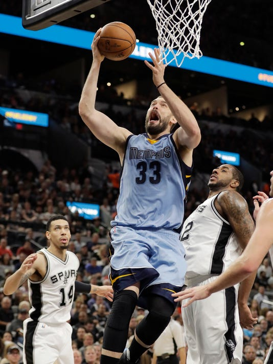Memphis Grizzlies center Marc Gasol (33) scores over San Antonio Spurs forward LaMarcus Aldridge (12) during the first half in Game 2 of a first-round NBA basketball playoff series, Monday, April 17, 2017, in San Antonio. (AP Photo/Eric Gay)