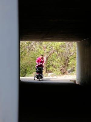 Maria Olivo of Salinas jogs into the underpass Friday morning at Natividad Creek Park in Salinas.