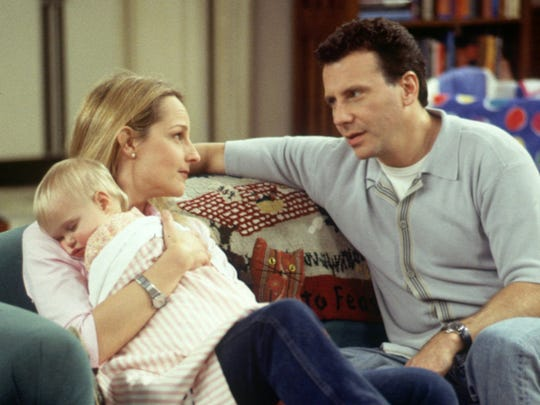 1996: On 'Mad About You,' Paul Reiser's sister Debbie (Robin Bartlett) announces she is gay and dating obstetrician Joan (Suzie Plakson).