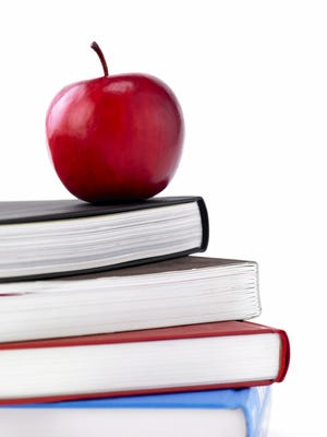 Book stack with apple