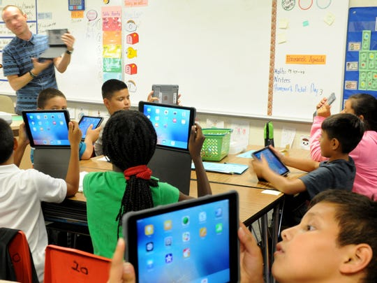 The fifth-grade students at Piru Elementary School learn to used their newly received iPads Thursday inside Derek Murphy's class. Apple provided one-to-one technology for every student and staff member at the school.