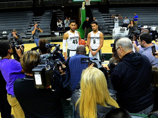 A throng of media members surround Denzel Valentine, right, and Bryn Forbes MSU men's basketball media day on Oct. 27. All eyes are on the two Lansing Sexton products this season.