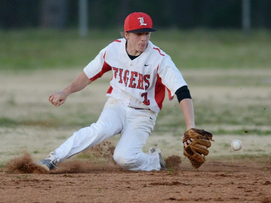 Lexington's Tucker White (2) stops the ball against Chester County on Monday at Guy B. Amis Park.