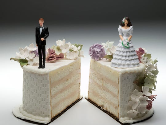 Bride and groom decorations on two pieces of wedding cake
