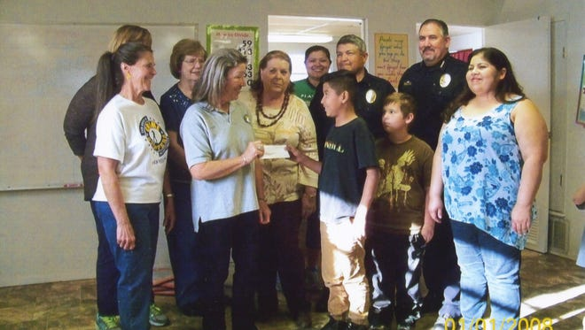 Members of Crime Stoppers, including David Peters and Deola Mitts, and San Angelo Police Department members, including Chief Frank Carter, Linda Ashton, Sarah Howell and Robert Martinez, received a $70 check from Ucello Lira from the Youth Advocate Program on Feb. 27.