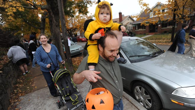 West Asheville's Vermont Avenue will close this year for trick-or-treating, as it has every year since 2013. The neighborhood hopes to make the street safe for families, like the one pictured here that visited the street in 2013.