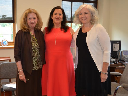Susan Gogan, Karen Pinzolo and Noreen Scott-Garrity, members of the SJCA Board of Trustees, are pictured inside the new SJCA office.
