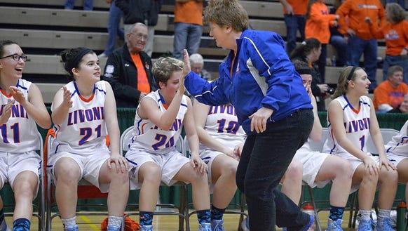 Livonia head coach Karen Schuster congratulates her