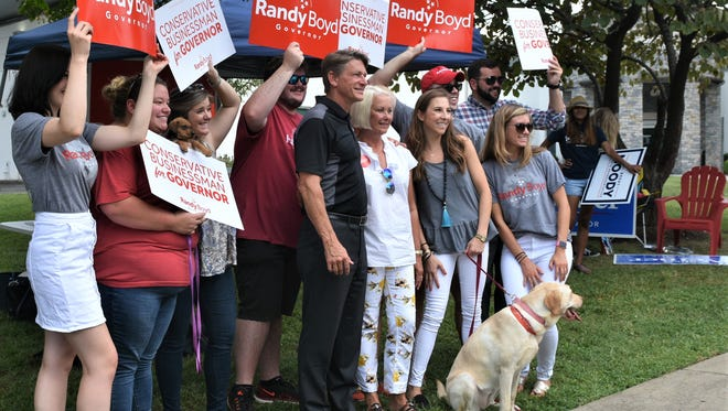 Randy Boyd is flanked by supporters at the Green Hills library.