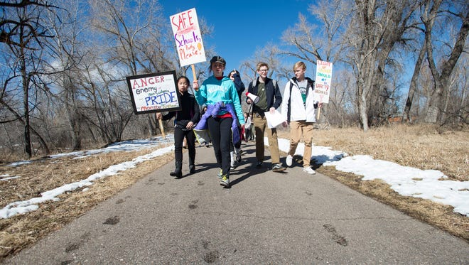 Students from Cache la Poudre Middle School begin a walk to Old Town on the Poudre Trail on Tuesday, February 27, 2018. The students walked out of school and will meet in Old Town to show solidarity with victims of the Parkland, Florida high school shooting.
