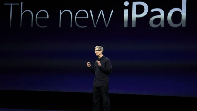 Apple CEO Tim Cook announces a new iPad during an Apple announcement in San Francisco.