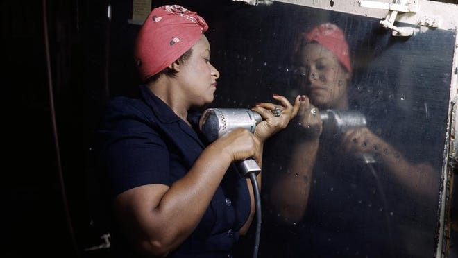 "A real-life ""Rosie the Riveter"" works on an A-31 Vengeance dive bomber, c. 1943. Willamette Heritage Center will host ""History Was Here: The Homefront in World War II — A Heritage Celebration"" Saturday, July 11."