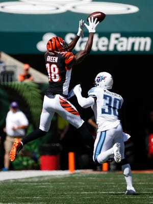 Bengals wide receiver A.J. Green makes a first-quarter reception over Titans cornerback Jason McCourty. Green caught six passes for 102 yards.