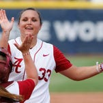 Alabama pitcher Jaclyn Traina high-fives catcher Molly Fichtner between innings against Oregon during an NCAA Women's College World Series softball tournament game in Oklahoma City on Sunday.