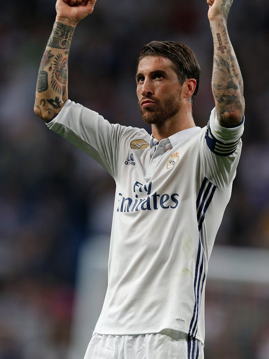 Real Madrid's Sergio Ramos gestures to supporters at the end of the La Liga soccer match between Real Madrid and Sevilla at the Santiago Bernabeu stadium in Madrid, Sunday, May 14, 2017. Real Madrid won 4-1. (AP Photo/Francisco Seco)
