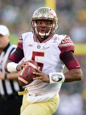 Florida State Seminoles quarterback Jameis Winston (5) drops back to pass against the Oregon Ducks during the first half in the 2015 Rose Bowl college football game at Rose Bowl.