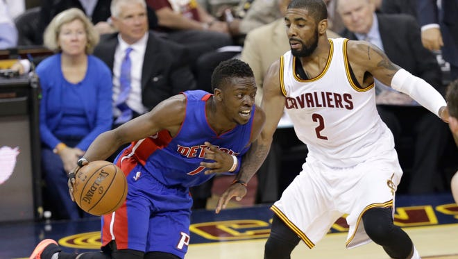 Pistons guard Reggie Jackson drive past Cavaliers guard Kyrie Irving in the first half in Game 2 of a first-round NBA playoff series April 20, 2016, in Cleveland.