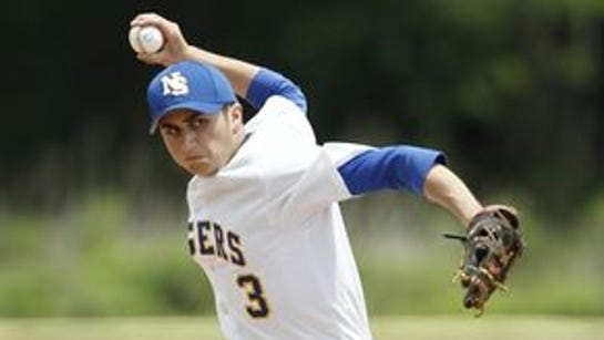 North Salem's Danny Capra (3) delivers a pitch in their