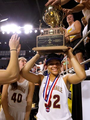 Riverdale senior Brinae Alexander holds up the TSSAA Class AAA state championship gold ball trophy after the Lady Warriors defeated Houston 77-50 for their third consecutive state title.