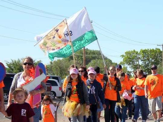 Walkers stretched for nearly two-thirds of a mile along the Voiers' Park walking path during the 1th annual Celebration of Life Cancer Walk in 2016.