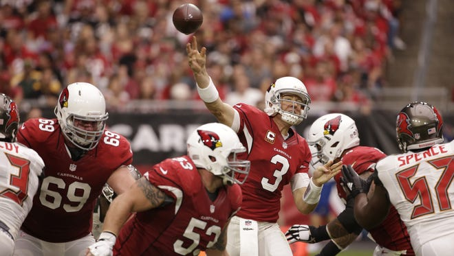 Arizona Cardinals quarterback Carson Palmer throws a pass against the Tampa Bay Buccaneers in the first half on Sept. 18, 2016 in Glendale.