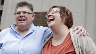 Jayne Rowse, left, and her partner April DeBoer make their way to the U.S Sixth Circuit Court of Appeals in Cincinnati Wednesday Aug. 6, 2014.