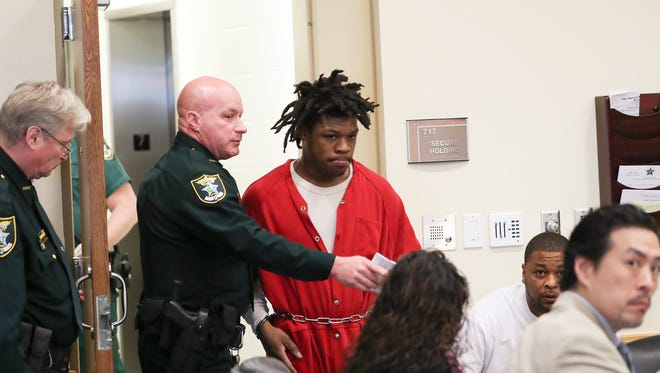 Terrance Moore, a former standout football player for Fort Myers High School enters a courtroom at the Lee County Courthouse on Monday 11/28/2016. He faces nine felony charges and has descended into alleged criminal activity. He was shot at Club Blu over the summer, then was arrested Oct. 30 and charged with 9 crimes, allegedly leading law enforcement on a 10-mile, 100-mile-per-hour car chase after, according to the police report, shooting several times into two houses on Market Street in Fort Myers.