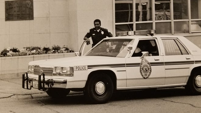 Officer Rainie Woods (Feb. 6, 1944 - Aug. 15, 2003) stands by his cruiser in front of old City Hall in Bremerton. Woods became Bremerton's first black police officer in 1969, 68 years after the city hired its first law enforcement official. Woods is fondly remembered by the community for his friendly and unique methods of law enforcement. To see more photos from the Kitsap County Historical Society Museum archives, visit facebook.com/kitsaphistory, kitsapmuseum.org, or stop by the museum at 280 Fourth St. in Bremerton. Call 360-479-6226 for information.